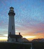 заход солнца маяка Стоковые Изображения RF