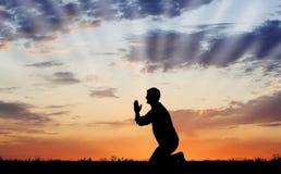 заход солнца молитве Стоковая Фотография