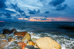 заход солнца моря каменный Стоковое фото RF