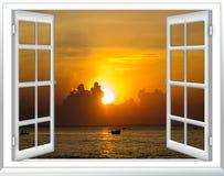Заход солнца моря от окна стоковое фото