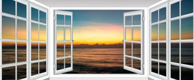 Заход солнца моря от окна стоковое фото rf