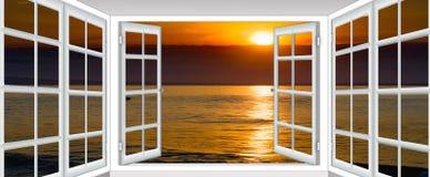 Заход солнца моря от окна стоковая фотография rf