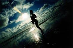 заход солнца моря саксофона сексуальный Стоковое фото RF