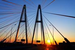 заход солнца моста автомобиля Стоковое фото RF