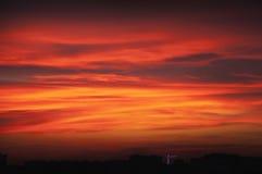 Заход солнца над городом стоковые фото