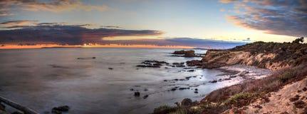 Заход солнца над кристаллическим пляжем парка штата бухты Стоковое Изображение RF