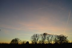 Заход солнца на начале весны стоковая фотография