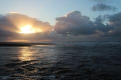 Заход солнца над морем увиденным на пляже Katwijk, Нидерландов Стоковое фото RF