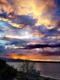 Заход солнца над проливом Мессины стоковые изображения