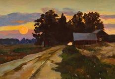Заход солнца над проселочной дорогой и деревней стоковые фото