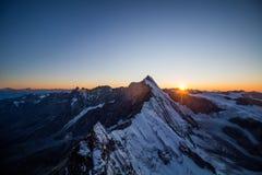 Заход солнца над alps стоковое фото rf