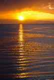 Заход солнца на воде Стоковая Фотография