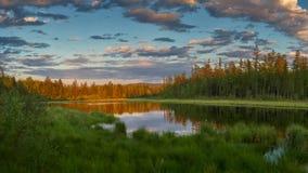 Заход солнца на далеком озере Стоковое Изображение