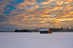 Заход солнца на день a очень холодный Стоковые Фотографии RF