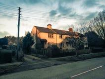 Заход солнца на домах в деревне Стоковое Фото