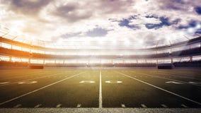 Заход солнца на панорамном взгляде футбольного стадиона стоковое фото