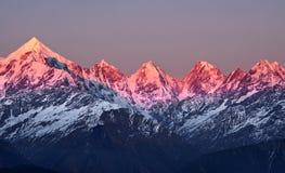Заход солнца на пиках panchachuli Стоковая Фотография