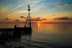 Заход солнца на пляже в Hunstanton, Норфолке Великобритании стоковые фотографии rf