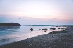 Заход солнца на пляже, длинном, стоковые фото