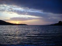 Заход солнца на пляже моря волны Стоковая Фотография RF