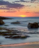 Заход солнца на пляже Birubi, Австралии Стоковые Фото