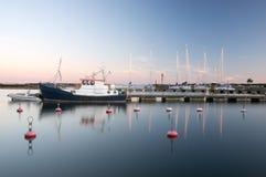 Заход солнца на порте Стоковая Фотография