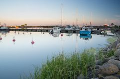 Заход солнца на порте Стоковые Фото