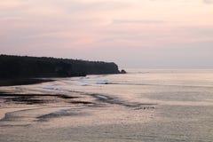 Заход солнца на скалах Bingin - Бали Стоковые Фото