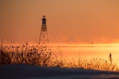Заход солнца на снеге и паре озера Стоковые Фотографии RF