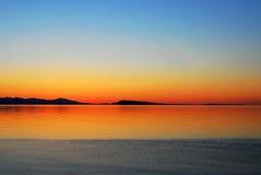 заход солнца неба моря стоковые изображения