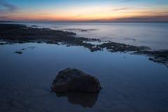 Заход солнца Норфолк Великобритания пляжа Hunstanton стоковые изображения