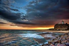 заход солнца океана маяка Стоковые Фотографии RF