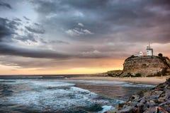 заход солнца океана маяка Стоковая Фотография