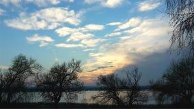 Заход солнца осени озером Стоковые Фото