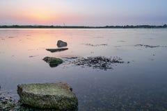 Заход солнца острова Hayling, Хемпшира стоковое фото rf