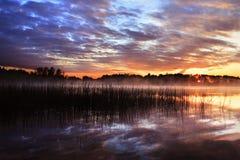 заход солнца отражения озера Стоковое Фото