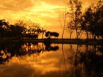 заход солнца отражения Стоковое Изображение