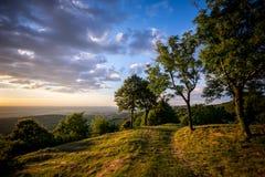 Заход солнца от зеленых холмов Юры Стоковое фото RF