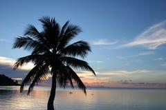 заход солнца очищенности пляжа Стоковые Фотографии RF