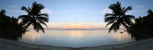 заход солнца очищенности пляжа Стоковые Фото