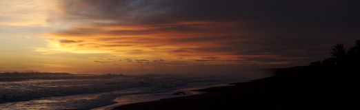 заход солнца панорамы пляжа Стоковое фото RF