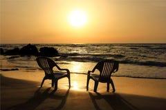 заход солнца пляжа унылый Стоковое Изображение