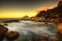 Заход солнца пляжа Южной Африки Кейптауна Стоковые Изображения RF