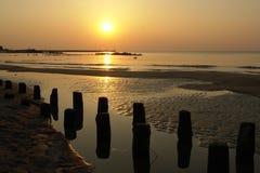 заход солнца пляжа Стоковые Изображения