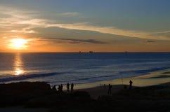 Заход солнца пляжа Carcavelos Стоковые Фото