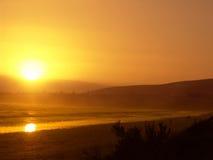 заход солнца померанца пляжа Стоковое фото RF