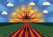 заход солнца посадки самолета Стоковое Фото
