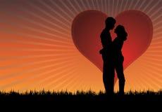 заход солнца поцелуя Стоковые Фотографии RF