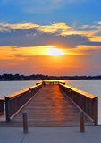 заход солнца пристани человека рыболовства Стоковое фото RF