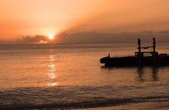 заход солнца пристани стоковое фото